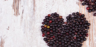 Elderberries on a countertop in the shape of a heart